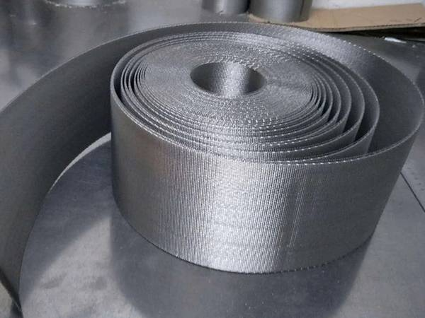 A roll of reverse dutch continuous filter belts on the table.