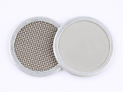 There are two stainless steel extruder screen filter discs showing their front and back.