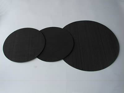 There are three black wire cloth extruder screen discs with different sizes.